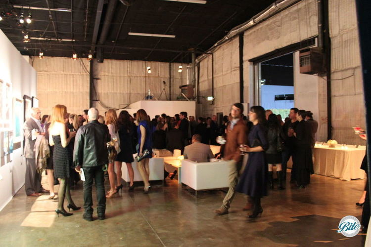 Crowd at an event in a studio space