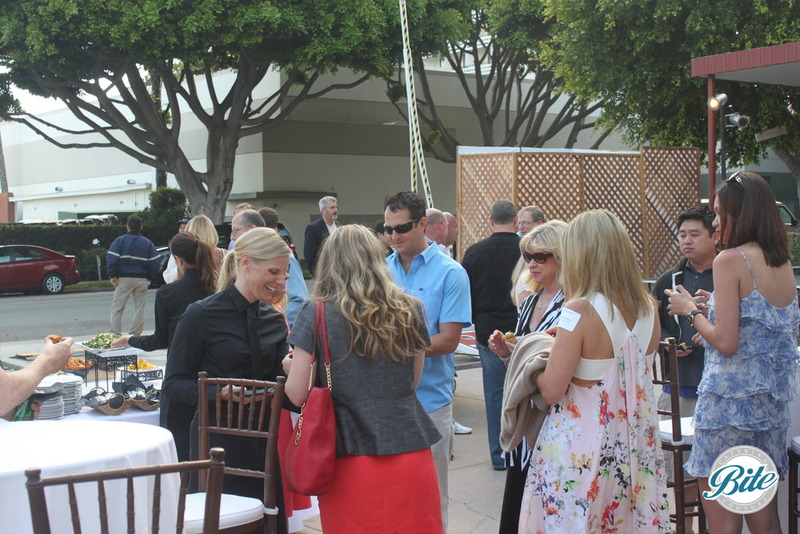 Santa Monica Company Anniversary Party Guests Eating Bites