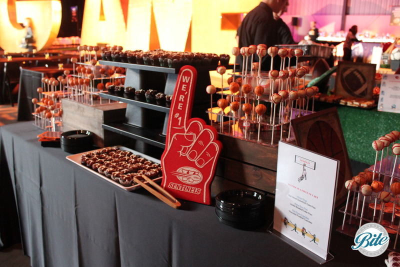 Sports themed dessert station including baseball cake pops and football brownies
