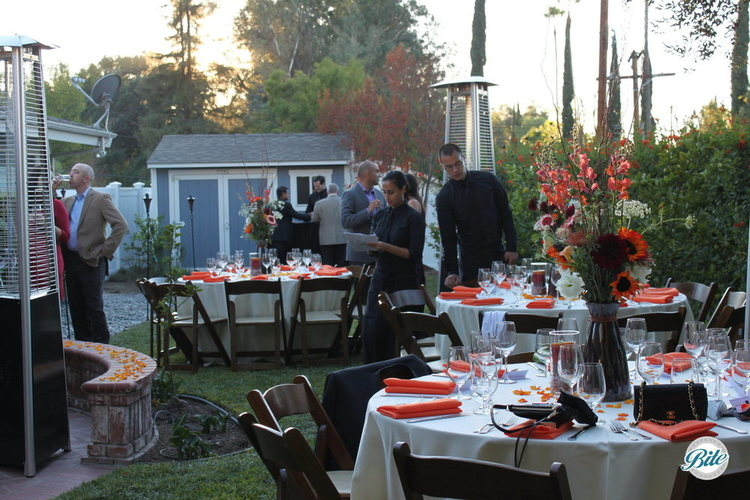 Tables set for a great dinner in a backyard wedding in Woodland Hills