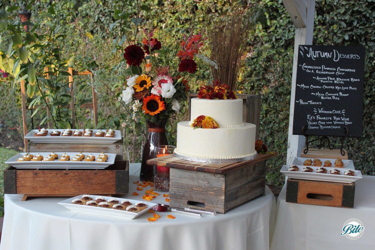 Fall themed wedding dessert station with cake