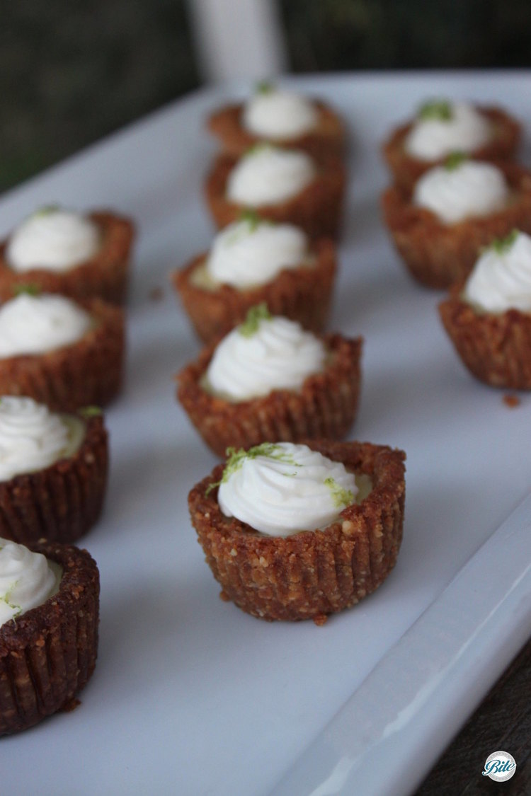 Mini cashew-crusted key lime pies with whipped cream