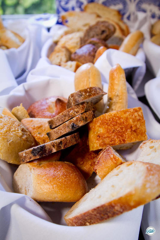 Artisan bread baskets ready for dinner service. Assorted sliced breads served with flavored butters