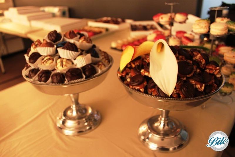 Decadent truffles on stationary dessert display with fresh flowers.