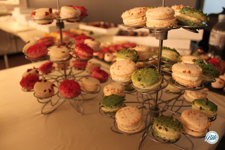 Pistachio, vanilla, and strawberry French macaron on seasonal holiday display