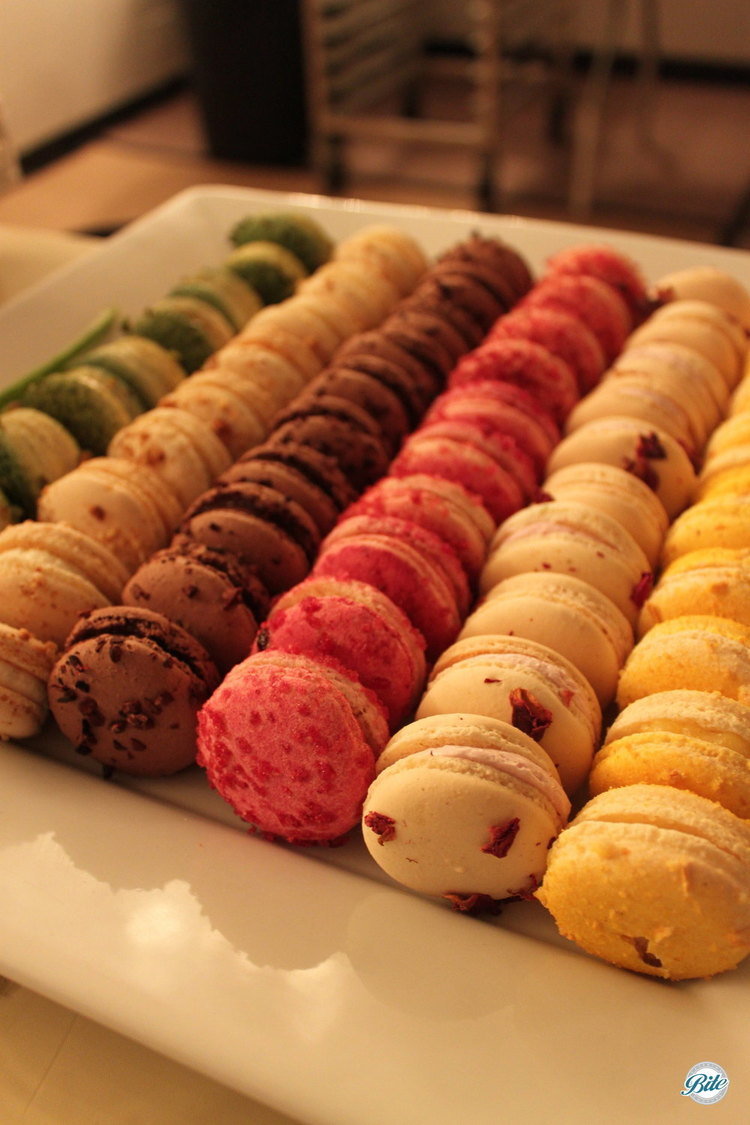 Assorted french macaron in rows on chic display