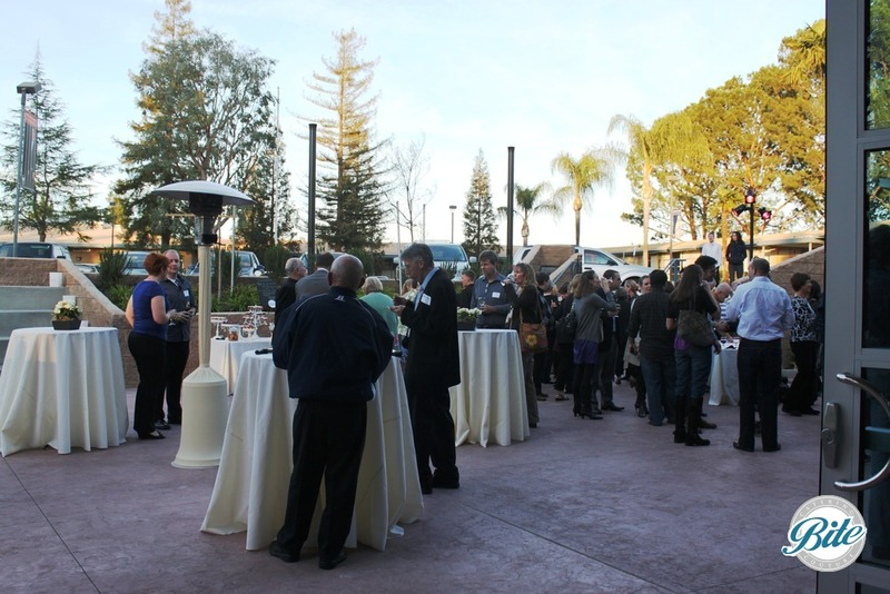 Outdoor cocktail reception in Los Angeles with guests mingling as they arrive