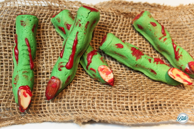 Bloody green witches finger bites.