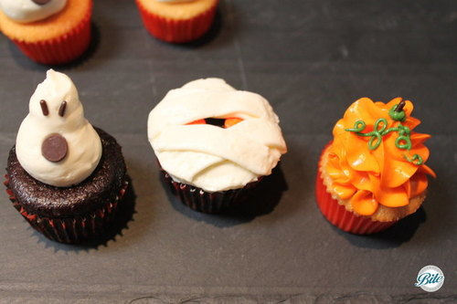 Closeup of ghost, mummy, and pumpkin cupcake.  Light, flaky, and delicious!