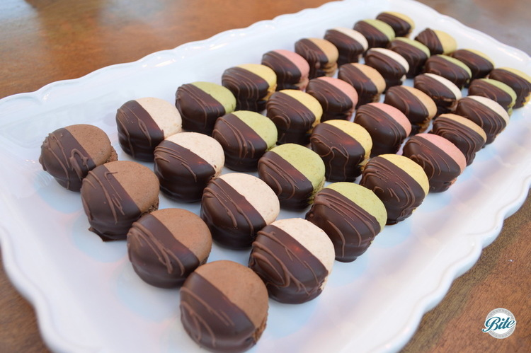 Chocolate dipped French macaron ready for dessert buffet