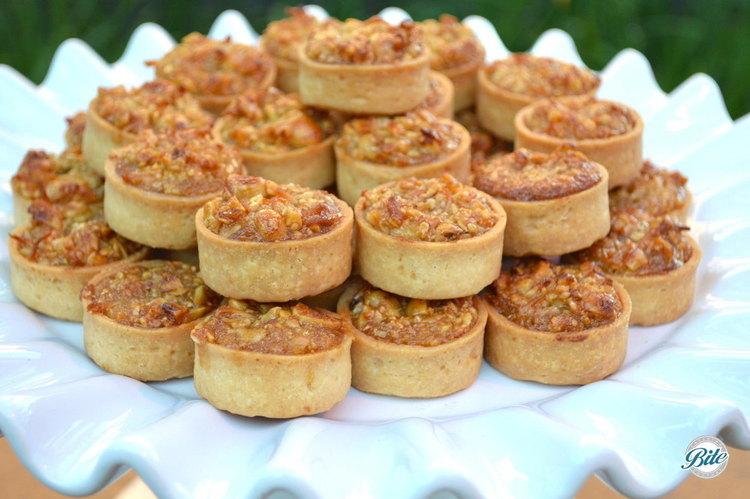 Mini pecan tart stacked on dessert display