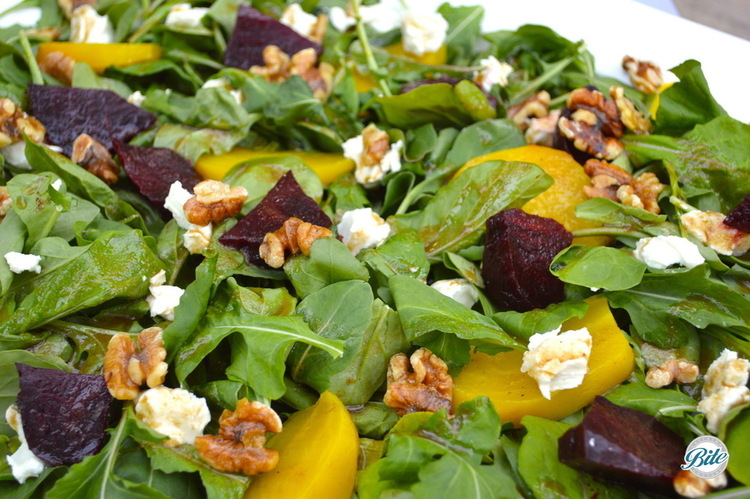 Roasted beet salad with cheese, walnuts, and honey balsamic dressing.