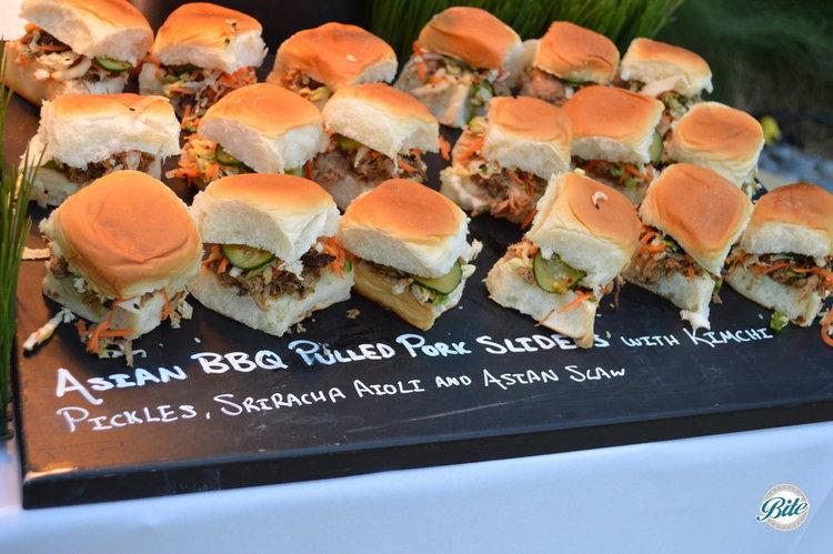 Asian BBQ pulled pork sliders with kimchi pickle, sriracha aioli and asian slaw