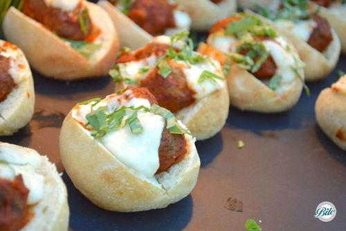 Mini meatball sliders with mozzarella, basil and marinara sauce