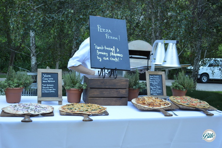 Hand tossed pizza action station with: white clam, BBQ chicken and vegetarian pizzas for guests