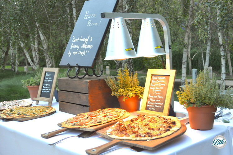 Pizza action station closeup on outdoor display ready for guests