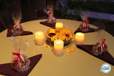 A beautiful display of the table setting at night with the candles lit