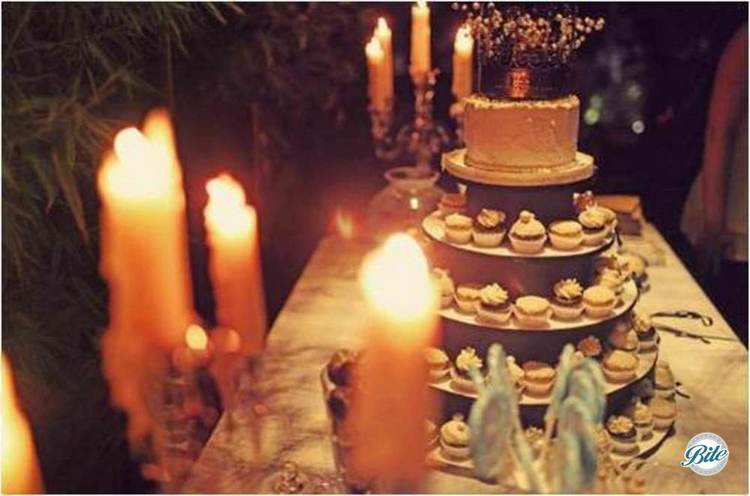Dessert bites surrounding a wedding cake topper
