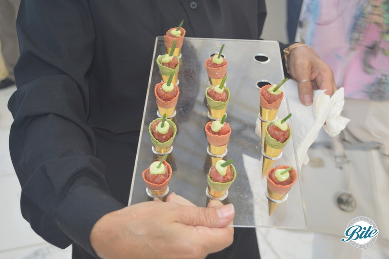 Ahi Tuna Tartare Served in a Vertical Cornet with Sriracha Vinaigrette, Avocado Cream and Chive Garnish