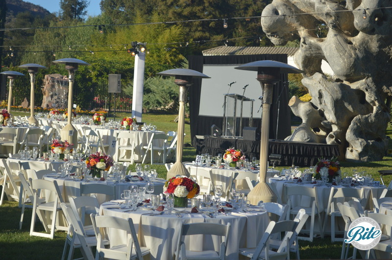 Table settings with farm to table theme at outdoor fundraising dinner