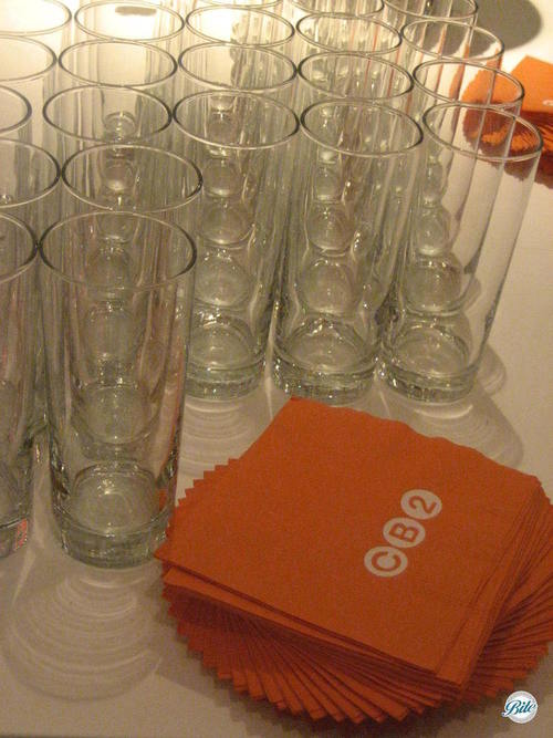 Shooter and napkin display for corporate grand opening event