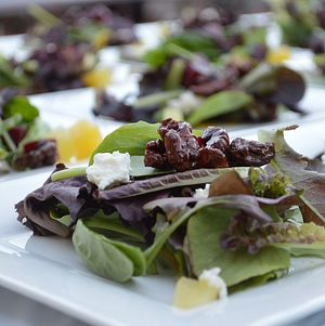 Plated Mixed Greens Beet Salad with goat cheese and candied walnuts