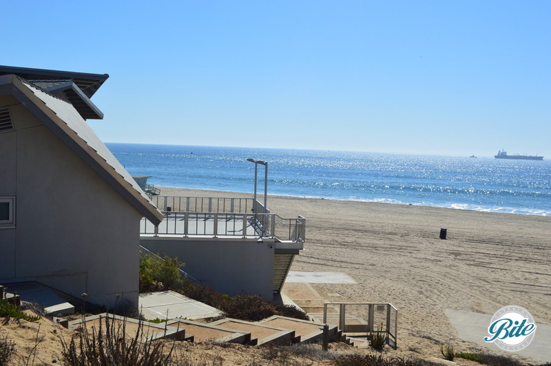 Photo of Dockweiler Beach Youth Center from the trail, showing the ocean view and balcony.