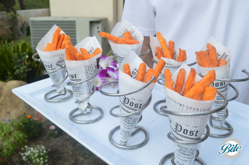 Sweet Potato Fries Served in handheld newspaper themed cones. Tray passed