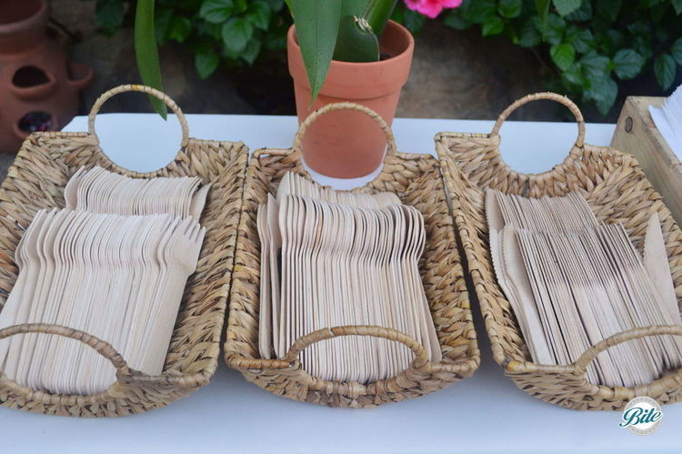 Wood cutlery set out in baskets
