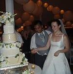Vijay Goel and Chef Elizabeth cutting the wedding cake