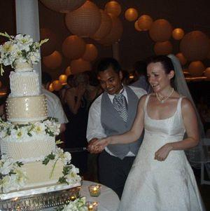 Vijay Goel and Chef Elizabeth cutting the wedding cake