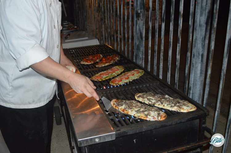 Grill behind Pizza station to make Pizzas fresh