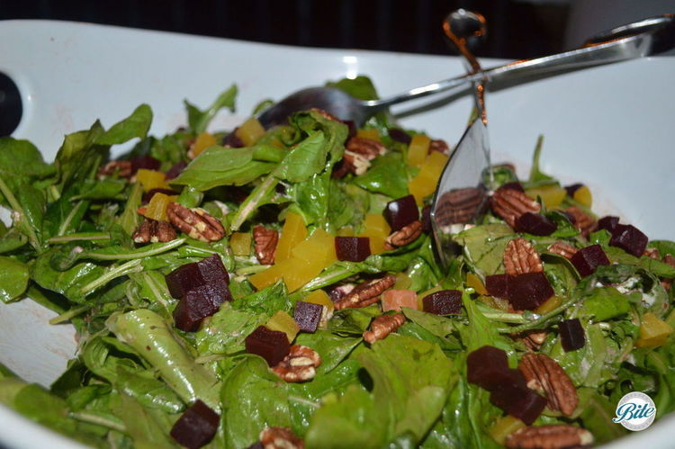 Roasted Autumn Red and Yellow Beets with arugula, goat cheese, toasted pecans and vinaigrette