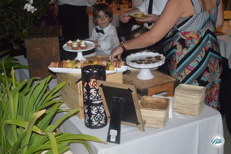 Guests enjoying dessert station at Wedding