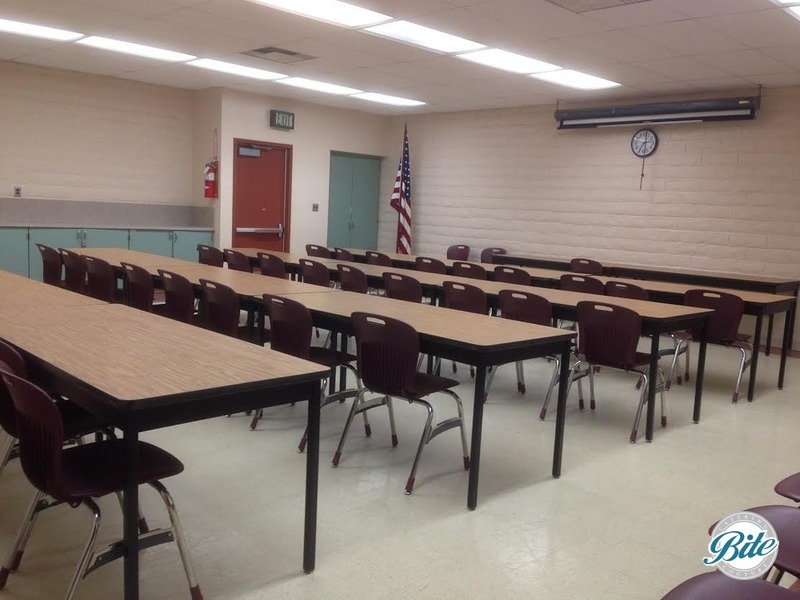 Inside of classroom with tables & chairs