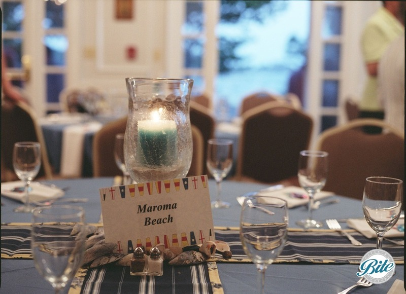 Nautical themed centerpiece with candle in hurricane vase