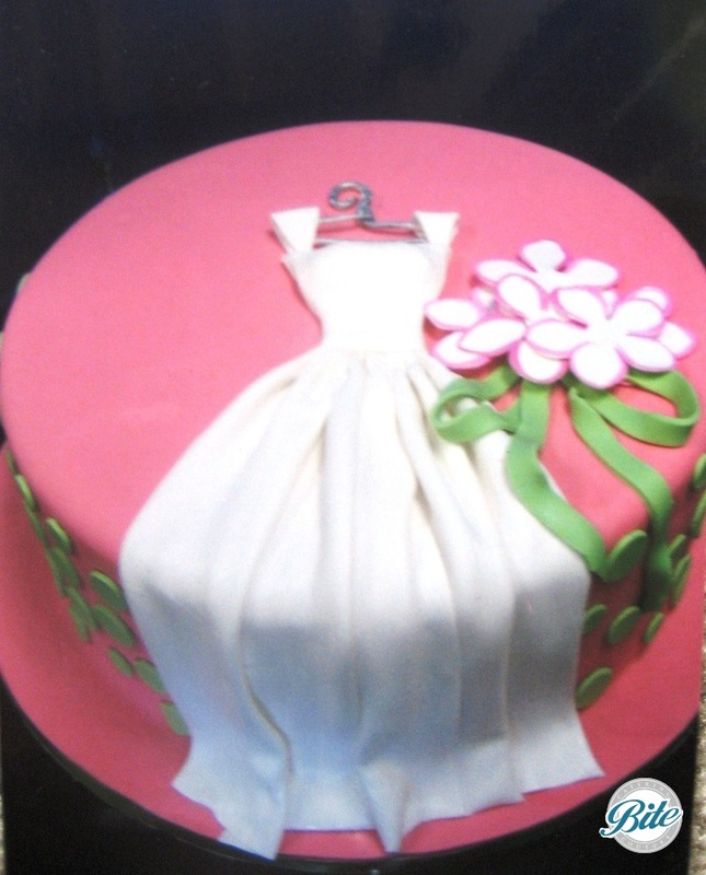 Pink bridal shower with wedding dress, ribbon and sugar flowers