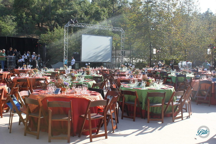 Tables set up and big screen for annual Fundraising Gala for Tree People LA