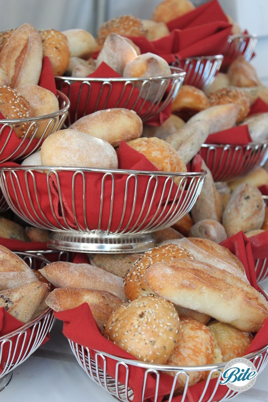 Bread baskets getting prepared for distribution to tables