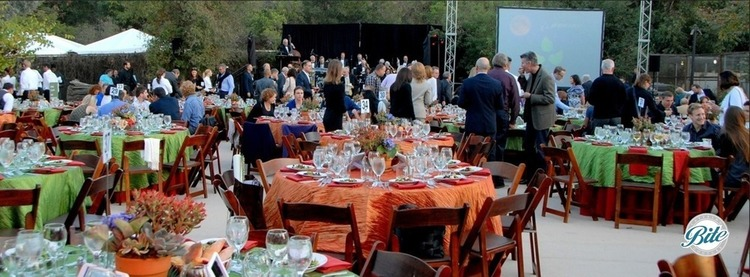 Fundraising dinner set with people heading to their tables