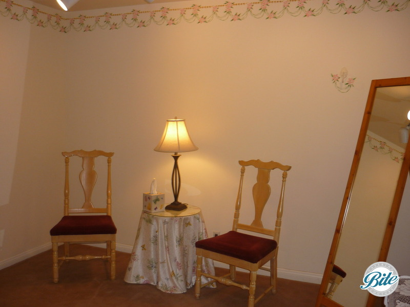 Bridal room with mirror, chairs, fan, desk and storage space