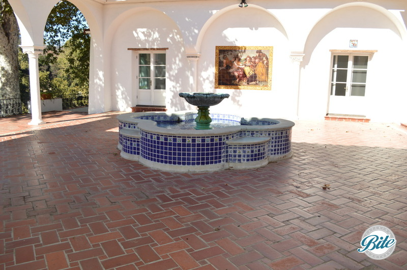 Courtyard of mansion with fountain and original mosaics