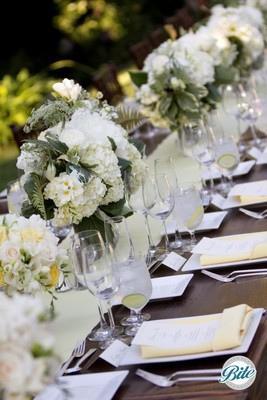 Beautiful spring tablescape in ivory, green and light yellow. Centerpieces, and table settings are ready for the event.