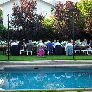 Intimate family-style wedding reception - One long table!