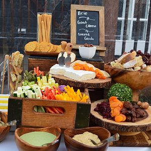 Artisan cheese, charcuterie, farmer's market crudite and olive oil tasting display