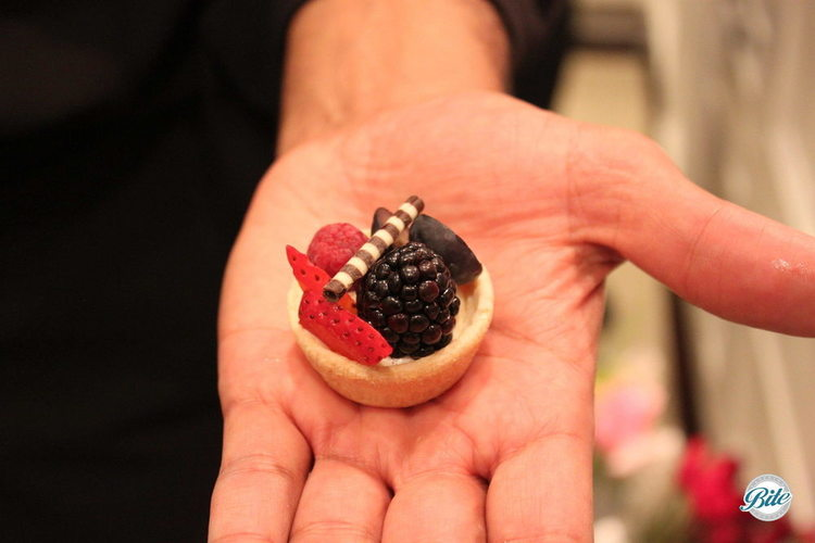 Our server modelling a fresh fruit tart with creme legere