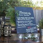 Hand-written chalkboard signage and fresh from the garden lavender and greenery