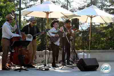 The Bluegrass band Big Bad Rooster entertaining guests by the pool.