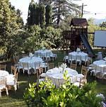 Dinner tables in lovely backyard setting
