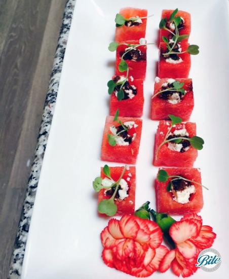 Watermelon cube salads with French feta, balsamic reduction and micro arugula